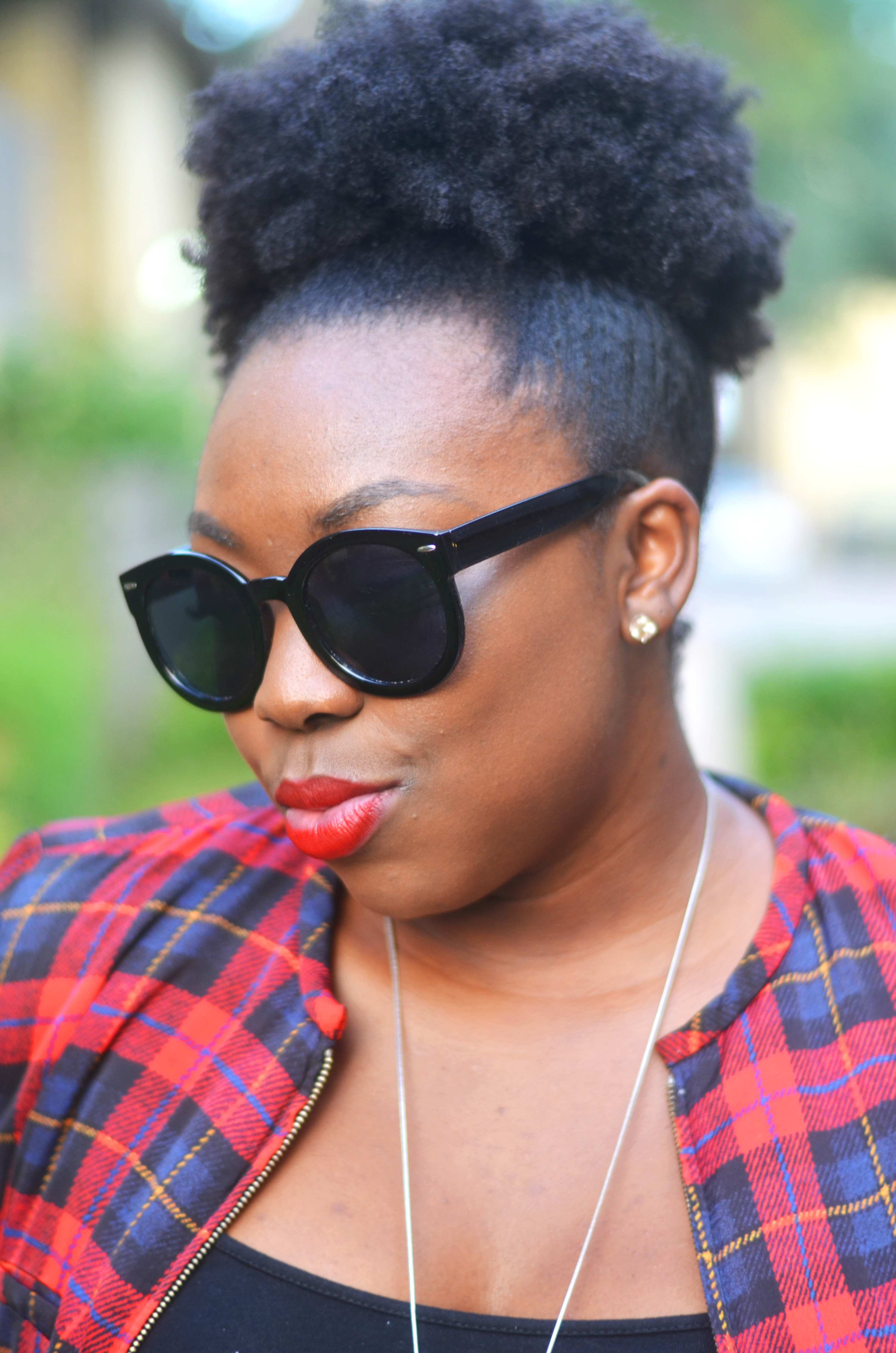 Red lips and afro puff